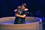 Associate Youth Director Calla Parker hugs Elise Duncan just after her baptism.