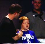 Josiah being baptized by Community Life Pastor Ted Coniaris