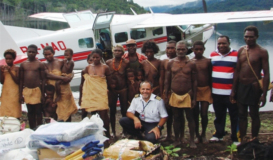 MAF pilot Tom with a group of the Weserau people