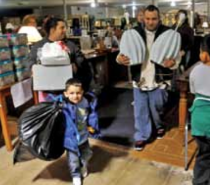 The Antonio family shops for replacement items with vouchers at Jubilee Furniture.