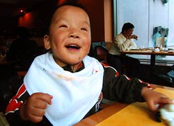 Isaac enjoying a restaurant meal in China