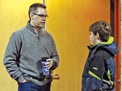 Brett, who serves in Student Ministry, talks with junior higher, Cameron Wilder.