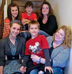 Michele Hogan, with friend Heather and four of her six children: Kyrie, 17, Karina, 15, Kaiden, 10, Karsten, 8