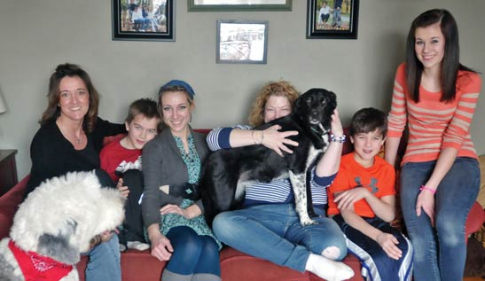 Michele Hogan, with friend Heather and four of her six children: Kyrie, 17, Karina, 15, Kaiden, 10, Karsten, 8, and family dogs.
