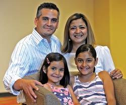 Hanibal and Heidi, with daughters, Alejandra and Camila