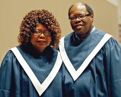 Shirley and Isaiah in the choir robes they wear on Sunday mornings during the traditional worship service.