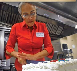 Preparing and serving meals and snacks is just one of the ways Nancy serves at WBC.
