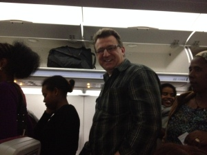 Mark boards his first overseas flight.