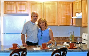 Timber Lake managers, Glen and Cornelia Mueller visit one of the brand-new kitchens.