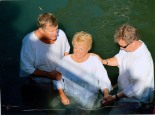 Barb's Baptism in the Jordan River—with Pastor Rob and Tom Doyle, who co-led the WBC Israel study tour