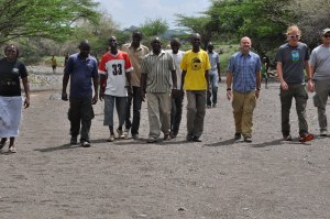 Members of the Turkana Pastors Fellowship, along with representatives from WBC and World Relief, walk to the site of the sand dam.