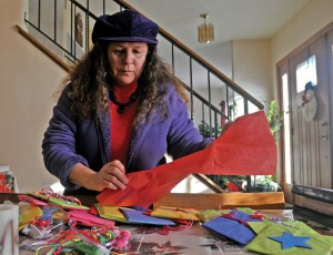 Marti, who can't always get out to volunteer, works on a project for WBC's Children's Ministry.