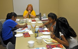 Joy shares her watercolor painting with Puente students this summer.