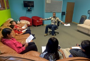 Wil listens as students respond to questions during their weekly Bible study.