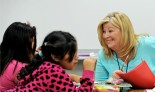 Judy McHugh, Puente volunteer working with students at Wegner School, Tuesday, October 20, 2015, in West Chicago, Illinois. (Jon Langham-for Wheaton Bible Church)