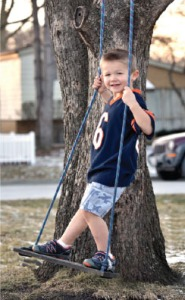 Levi demonstrates how much fun a tree swing can be!