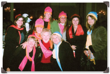Martha with her Place 4 You study group at a women's event, all wearing the hats and scarves she gave them that evening