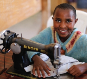 One of Josephine's vocational- training students learns dressmaking