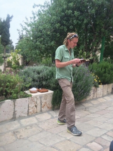 Kyle reads Scripture as the group prepares for Communion in Jerusalem.